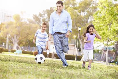 Gonzalez Family Playing Soccer in Park